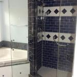 Full Custom Bathroom with corner jacuzzi tub, hand built cabinetry, and multi-valved  shower fixture.