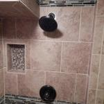 Designer Shower with Mosaic Accents and Built-in Soap Dish.