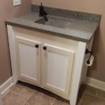 Custom Vanity and Concrete Countertop to  Match Wet Bar