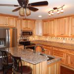 Designer Kitchen with Custom Hickory Cabinets and Quartz Counter-tops and Hand Scraped Hardwood Floor