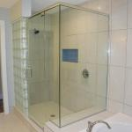 Master Bath with Glass Block Wall, Frame-less Glass, and Soaker Tub