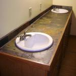 Slate-topped double vanity with custom hand-built cabinetry