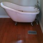 Acrylic claw foot tub with new flooring