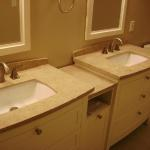 Updated granite double vanity in contemporary neutral tones